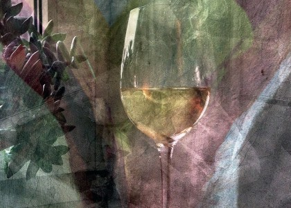The Collector Of White Wine In Glasses